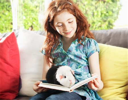 red hair preteen girl - Girl reading with pet hamster Stock Photo - Premium Royalty-Free, Code: 635-05551121
