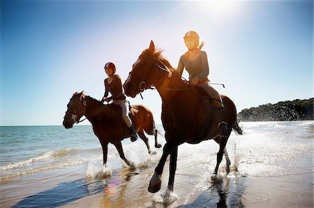 Girls riding horses on beach Stock Photo - Premium Royalty-Free, Code: 635-05551122