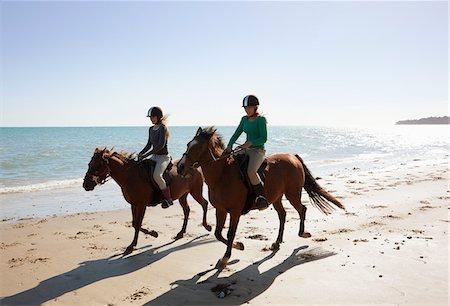 Girls riding horses on beach Stock Photo - Premium Royalty-Free, Code: 635-05551134