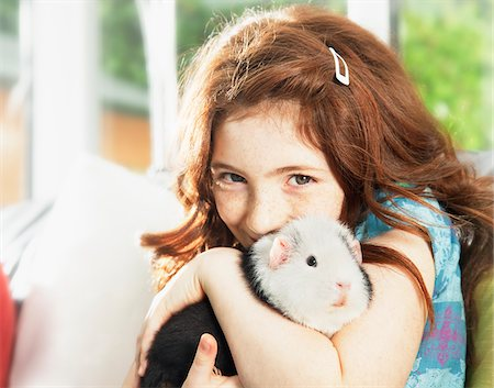 red hair preteen girl - Girl hugging pet hamster Stock Photo - Premium Royalty-Free, Code: 635-05551141