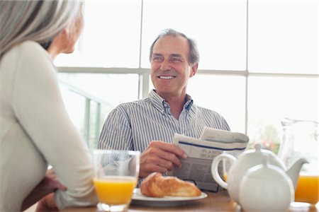 Smiling senior couple at breakfast table Stock Photo - Premium Royalty-Free, Code: 635-05655700