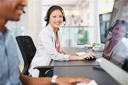 sale - Portrait of confident businesswoman with headset at computer in office Stock Photo - Premium Royalty-Free, Code: 635-05655918