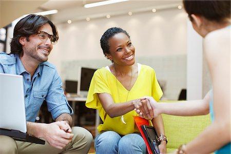 Businesswomen handshaking in meeting Stock Photo - Premium Royalty-Free, Code: 635-05656063