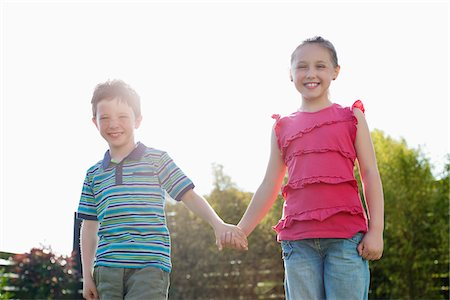 Portrait of smiling boy and girl holding hands Stock Photo - Premium Royalty-Free, Code: 635-05656124