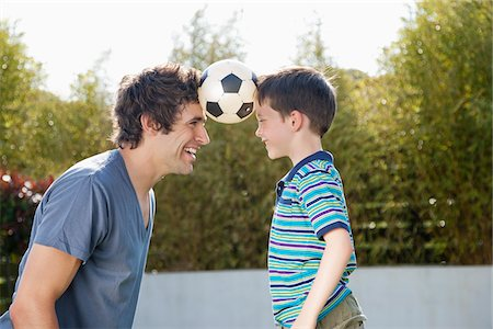 recreation - Soccer ball between father and son Stock Photo - Premium Royalty-Free, Code: 635-05656145
