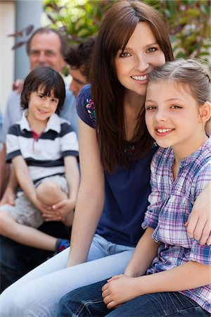 Portrait of smiling multi-generation family outdoors Stock Photo - Premium Royalty-Free, Code: 635-05656142