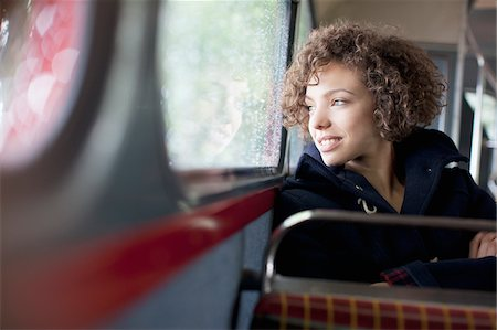 expectation - Smiling woman riding bus Stock Photo - Premium Royalty-Free, Code: 635-05656332