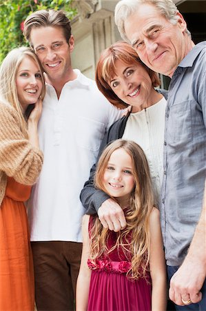 Portrait of smiling multi-generation family Stock Photo - Premium Royalty-Free, Code: 635-05656417