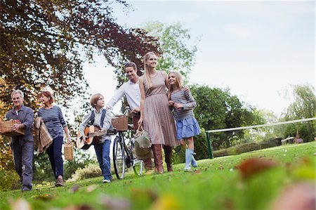 Multi-generation family with picnic baskets walking in park Stock Photo - Premium Royalty-Free, Code: 635-05656440