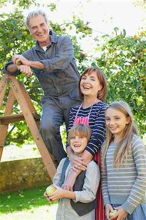 family apple orchard - Smiling multi-generation family in apple orchard Stock Photo - Premium Royalty-Free, Code: 635-05656457