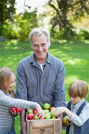 family apple orchard - Grandfather and grandchildren with bushel of apples in orchard Stock Photo - Premium Royalty-Free, Code: 635-05656480