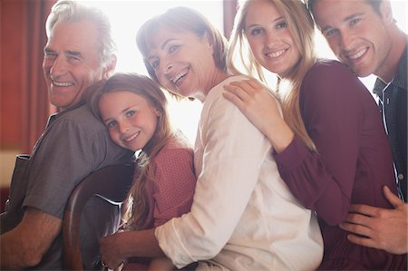 Portrait of smiling multi-generation family in a row Stock Photo - Premium Royalty-Free, Code: 635-05656483