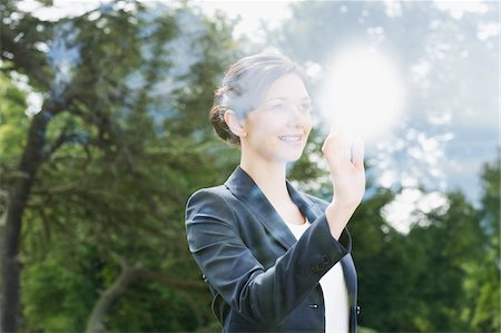 Businesswoman looking out window Stock Photo - Premium Royalty-Free, Code: 635-05651406