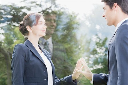 Business people looking at each other through glass Stock Photo - Premium Royalty-Free, Code: 635-05651418