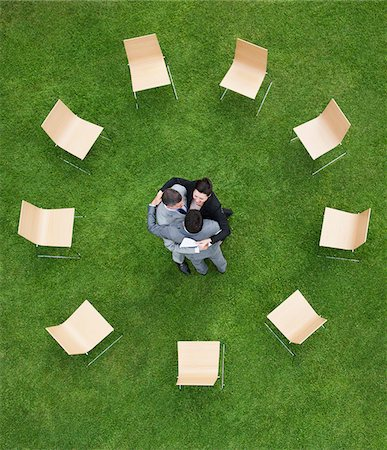 Business people hugging outdoors Stock Photo - Premium Royalty-Free, Code: 635-05651425