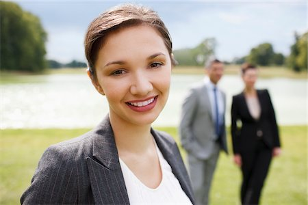 Business people standing together outdoors Stock Photo - Premium Royalty-Free, Code: 635-05651447