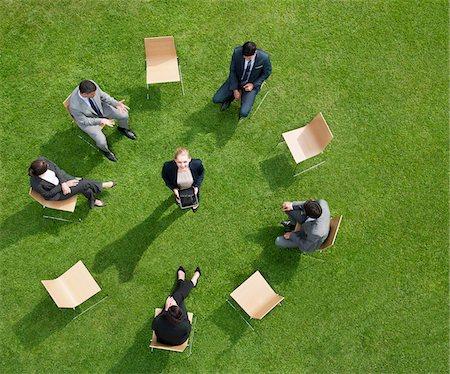 Business people having meeting outdoors Stock Photo - Premium Royalty-Free, Code: 635-05651449