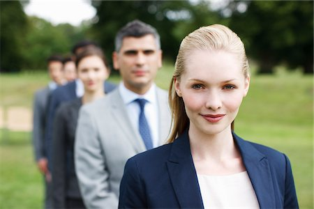 Business people standing in line together outdoors Stock Photo - Premium Royalty-Free, Code: 635-05651443