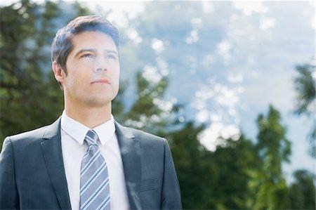 Businessman looking through window Stock Photo - Premium Royalty-Free, Code: 635-05651455