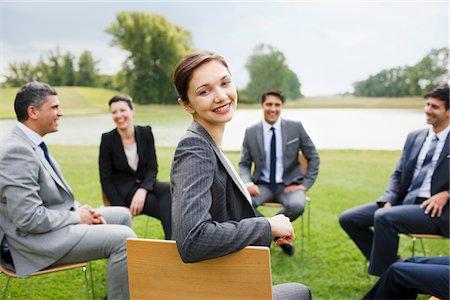 Business people having meeting outdoors Stock Photo - Premium Royalty-Free, Code: 635-05651464