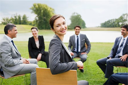Business people having meeting outdoors Stock Photo - Premium Royalty-Free, Code: 635-05651464
