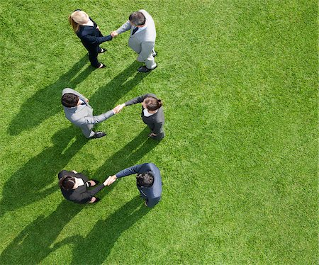 Business people shaking hands together outdoors Stock Photo - Premium Royalty-Free, Code: 635-05651478