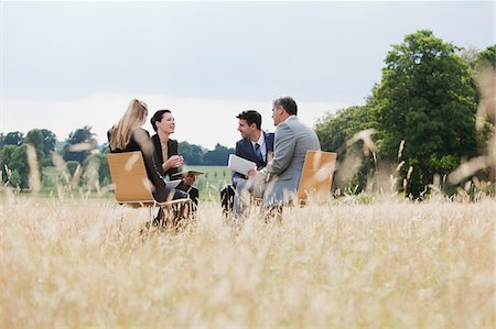 Business people having meeting outdoors Stock Photo - Premium Royalty-Free, Code: 635-05651481