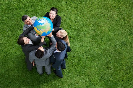 Business people lifting globe together outdoors Stock Photo - Premium Royalty-Free, Code: 635-05651496