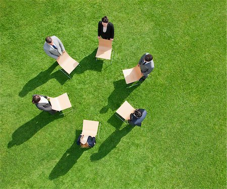 Business people in outdoor meeting standing in circle Stock Photo - Premium Royalty-Free, Code: 635-05651493