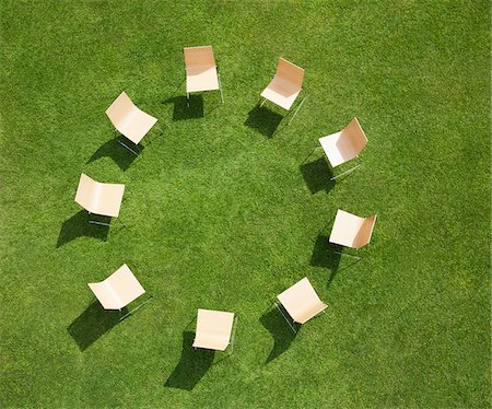 Chairs in circle formation on grass Stock Photo - Premium Royalty-Free, Code: 635-05651503