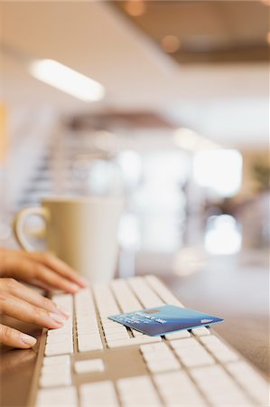 Close up of woman credit card and woman typing on keyboard Stock Photo - Premium Royalty-Free, Code: 635-05651521
