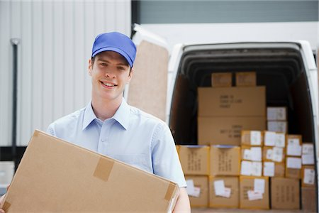 dependable - Deliveryman carrying box from van Stock Photo - Premium Royalty-Free, Code: 635-05651535