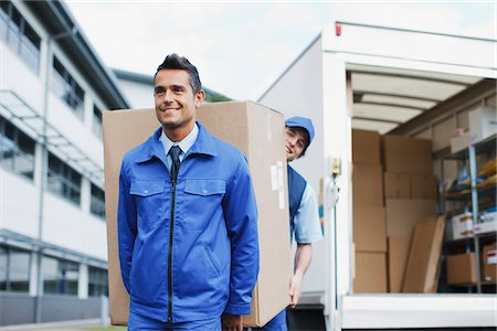 Deliverymen carrying large box from van Stock Photo - Premium Royalty-Free, Code: 635-05651545