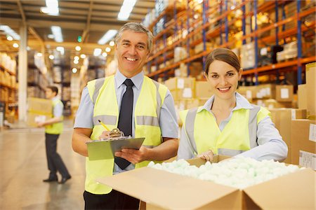 Workers in warehouse standing near box Stock Photo - Premium Royalty-Free, Code: 635-05651554