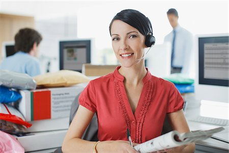 Businesswoman working at desk in headset Stock Photo - Premium Royalty-Free, Code: 635-05651560