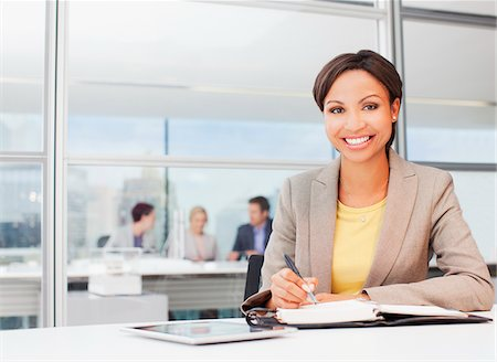 planner - Businesswoman working at desk in office Stock Photo - Premium Royalty-Free, Code: 635-05651586