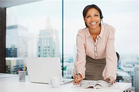 Businesswoman working at desk Stock Photo - Premium Royalty-Free, Code: 635-05651594