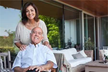 Smiling couple relaxing together on patio Stock Photo - Premium Royalty-Free, Code: 635-05651746
