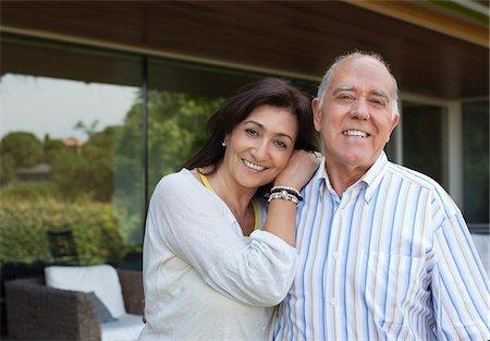 Smiling couple standing on patio Stock Photo - Premium Royalty-Free, Code: 635-05651777