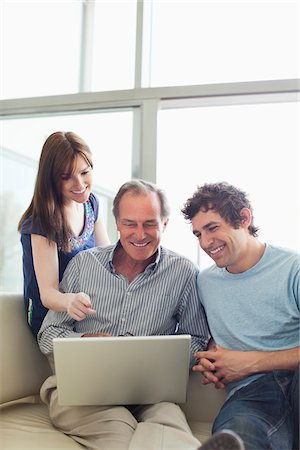Friends using laptop together Stock Photo - Premium Royalty-Free, Code: 635-05651865