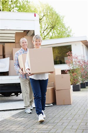 Couple unloading boxes from moving van Stock Photo - Premium Royalty-Free, Code: 635-05652125