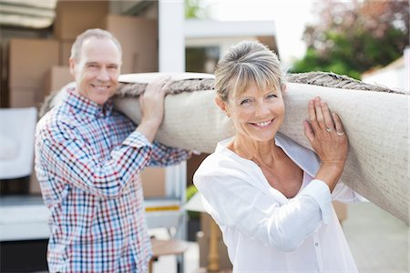 Couple carrying rug together Stock Photo - Premium Royalty-Free, Code: 635-05652126