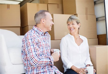 Couple drinking coffee on back of moving van Stock Photo - Premium Royalty-Free, Code: 635-05652133
