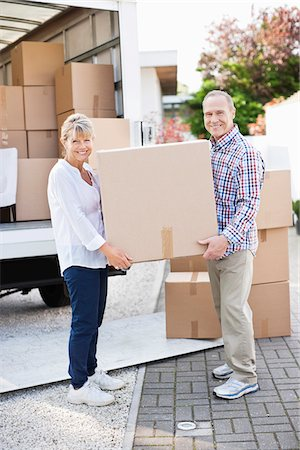Couple unloading boxes from moving van Stock Photo - Premium Royalty-Free, Code: 635-05652148