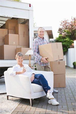 Couple unloading moving van Stock Photo - Premium Royalty-Free, Code: 635-05652169