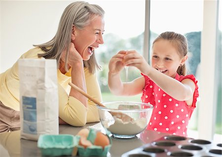 Grandmother and granddaughter baking cupcakes Stock Photo - Premium Royalty-Free, Code: 635-05652179