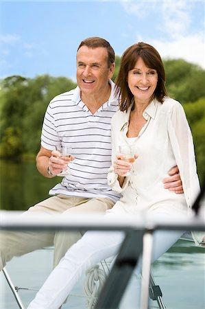 Couple sitting on boat drinking Stock Photo - Premium Royalty-Free, Code: 635-05652296