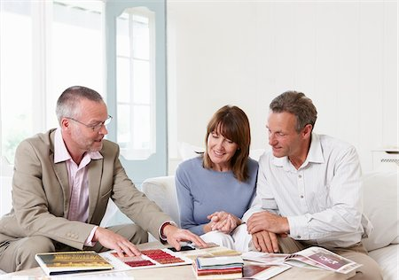 Interior designer showing samples to customers Stock Photo - Premium Royalty-Free, Code: 635-05652308