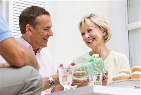 Man giving wife birthday gift Stock Photo - Premium Royalty-Free, Code: 635-05652300