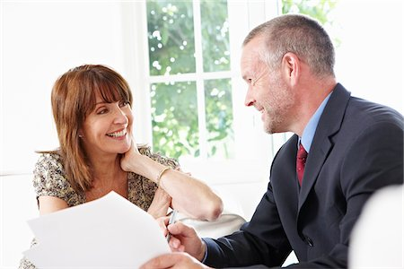 Financial advisor talking to customer Stock Photo - Premium Royalty-Free, Code: 635-05652327